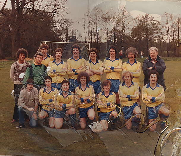A football photo with broken glass and water damage in badly need of restoration