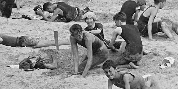 Boys bury a girl in the sand 1900