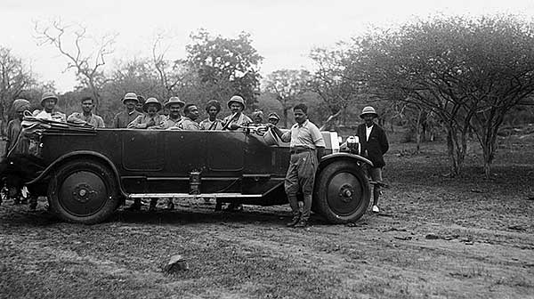 old glass plate showing hunting party arrived by charabanc, just take out your rifle and shoot!