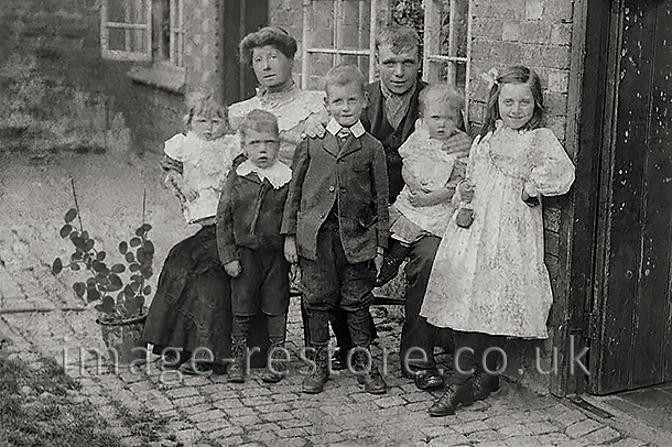 Aurthur and Alice Wixon and their family 1908 photo restored.