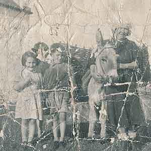 Badly damaged sepia photo coloured