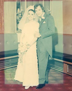 A heavily faded colour photo before restoration